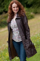 Ladies Leather modern draw string parka.